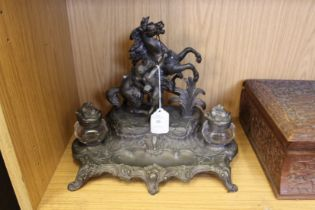 A spelter desk stand with a Marley horse style mount.