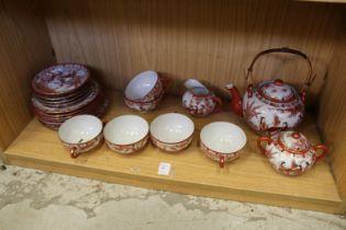 A Japanese egg shell porcelain tea service.