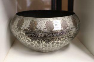 An eastern metal bowl.