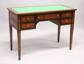 A MAHOGANY AND ROSEWOOD WRITING DESK, with green leathercloth writing surface, five drawers on