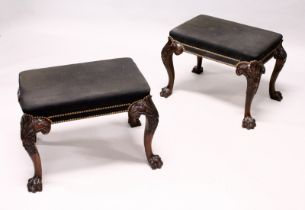 A GOOD PAIR OF GEORGE III DESIGN MAHOGANY RECTANGULAR STOOLS, with brass studded black cloth