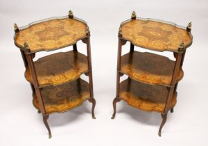 A PAIR OF EARLY 20TH CENTURY FRENCH MARQUETRY AND ORMOLU MOUNTED THREE TIER ETAGERES, with galleried
