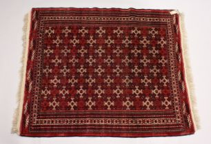 A TURKOMEN YAMUD CARPET, red ground with all over geometric design. 5ft 10ins x 4ft 8ins