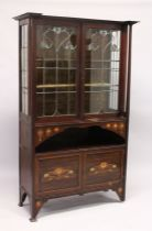 AN ART NOUVEAU MAHOGANY INLAID CHINA CABINET with a pair of leaded glass doors over an open space,