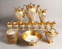 A GOOD PARIS GILDED TEA SET, comprising eight cups and nine saucers, tea pot, coffee pot, sugar