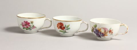 THREE 19TH CENTURY BERLIN CUPS painted with flowers. Septre mark in blue.