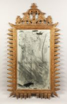 A DECORATIVE PIER MIRROR, 20th Century with a pagoda style cresting and leaf carved frame. 4ft