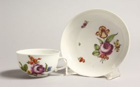 A 19TH CENTURY VIENNA COFFEE CUP AND SAUCER painted with flowers. Mark in blue