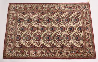 A GOOD PERSIAN KAHAN CARPET, cream ground with vases of flowers. 6ft 7ins x 4ft 5ins