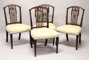 A SET OF FOUR HEPPLEWHITE DESIGN MAHOGANY DINING CHAIRS, with arched top, carved vertical tie