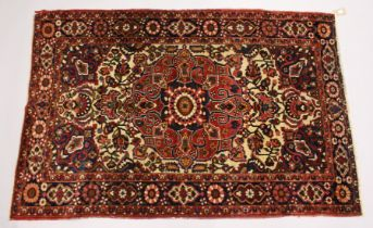 A PERSIAN BAKHTIAR CARPET, cream ground with all over floral design. 6ft 8ins x 4ft 4ins