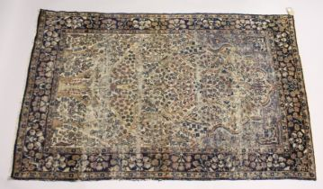 A PERSIAN KERMAN CARPET, cream groud with a stylised tree design. 7ft x 4ft 5ins