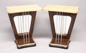A PAIR OF UNUSUAL CREAM LACQUERED AND ROSEWOOD CONSOLE TABLES, the tops supported by three metal