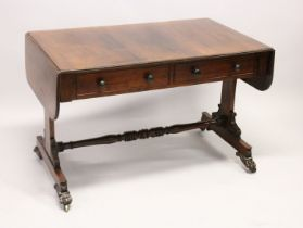 A GOOD REGENCY ROSEWOOD SOFA TABLE, with folding flaps, two single drawers with replacement wooden