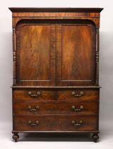 A 19TH CENTURY LINEN PRESS, with a moulded cornice above a pair of panelled doors with tuned
