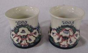 Pair of Moorcroft mugs dated 2003, one signed by the artist - open day