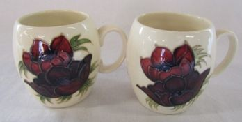 2 Moorcroft anemone mugs dated 1985 one marked Liberty H 9.5 cm