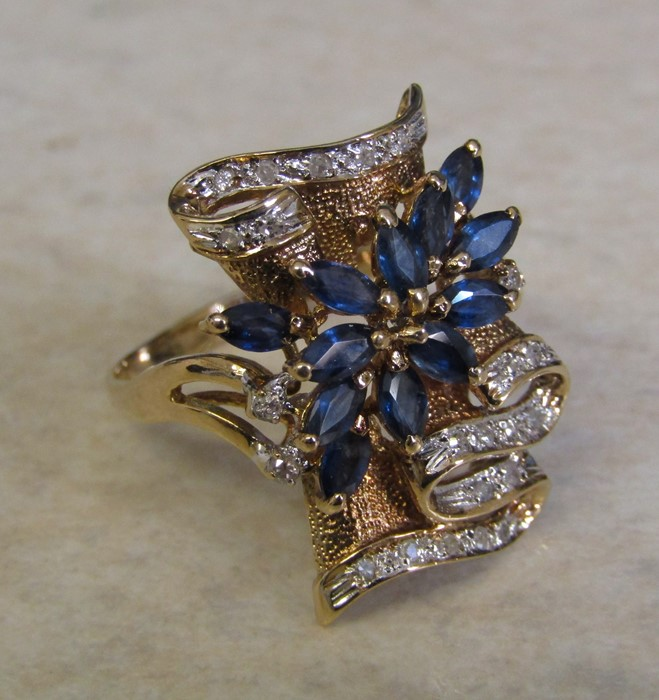 Tested as 14ct gold (marked 14k) sapphire and diamond ring, with 13 marquise cut sapphires 4 x 2. - Image 8 of 12