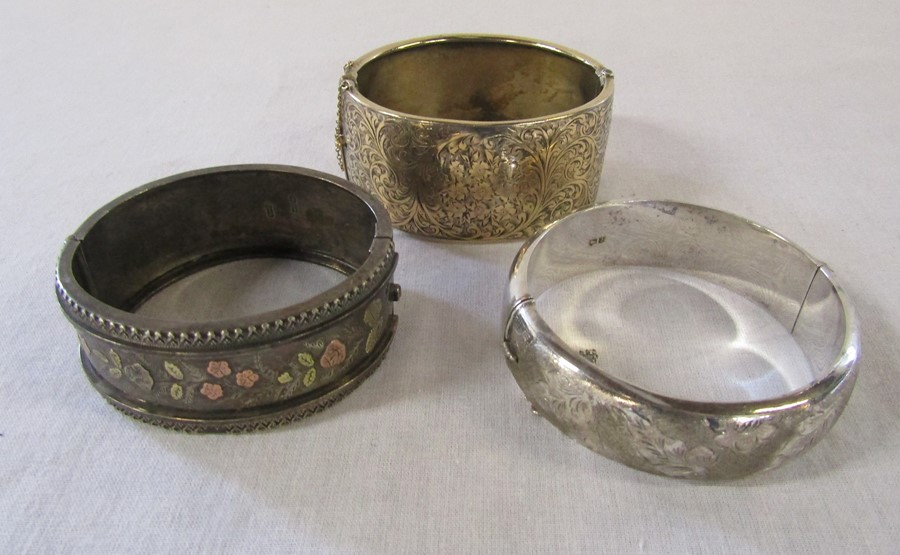 3 silver bangles - leaf pattern Birmingham 1965 weight 1.35 ozt, coloured flowers and leaves