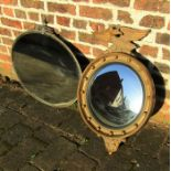 Regency style gilt framed convex mirror with eagle mount H 71 cm and a bevel edge oval mirror L 77.5