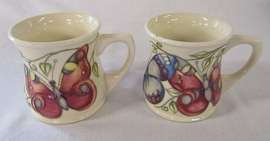 2 Moorcroft 'butterfly' pattern mugs H 8.5 cm