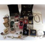 Selection of costume jewellery inc mourning pendant, travel clocks, cigarette lighters etc