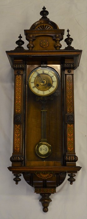 Vienna regulator wall clock with a 2 train spring driven mechanism with stained wood decorated