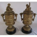 Pair of classical style gilt metal lidded urns decorated with cherubs and vines H 40 cm