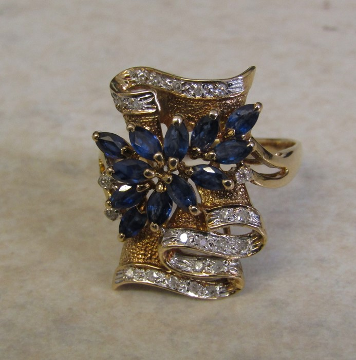 Tested as 14ct gold (marked 14k) sapphire and diamond ring, with 13 marquise cut sapphires 4 x 2. - Image 3 of 12
