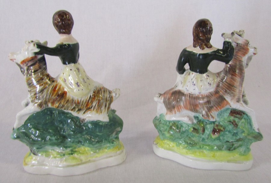 Pair of Staffordshire flatback figures of children / young girls riding goats possibly with some - Image 2 of 3