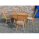 Ercol drop leaf table (marked top) 112cm by 124cm & 4 Ercol comb back chairs