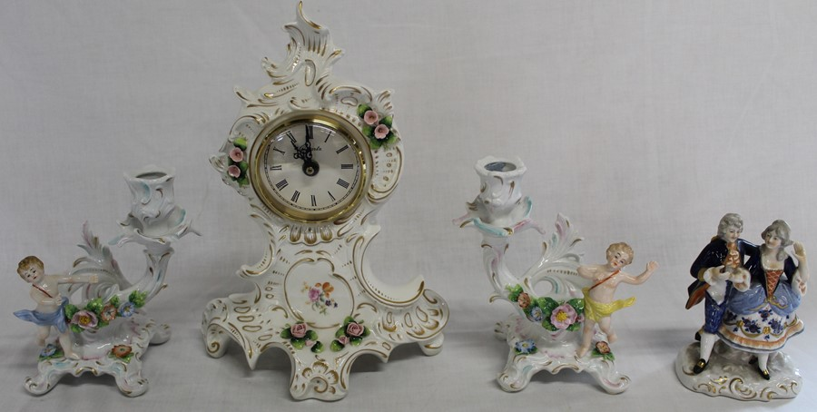 Sitzendorf floral encrusted clock, pair of cherub candelabra and Unter Weiss Bach figural group