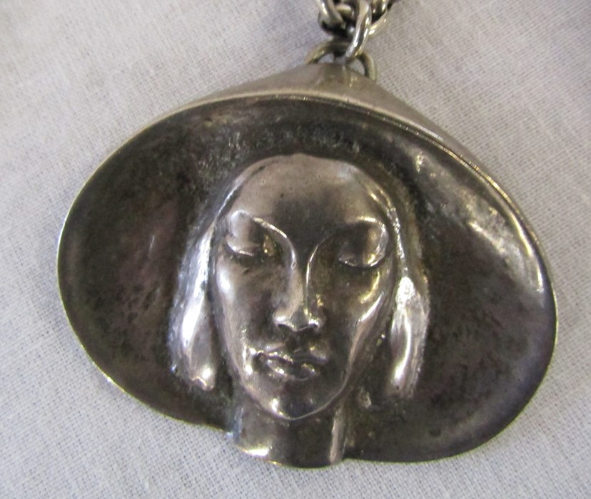Large silver pendant of a woman in a hat weight 1.08 ozt on a white metal chain & a silver - Image 2 of 3