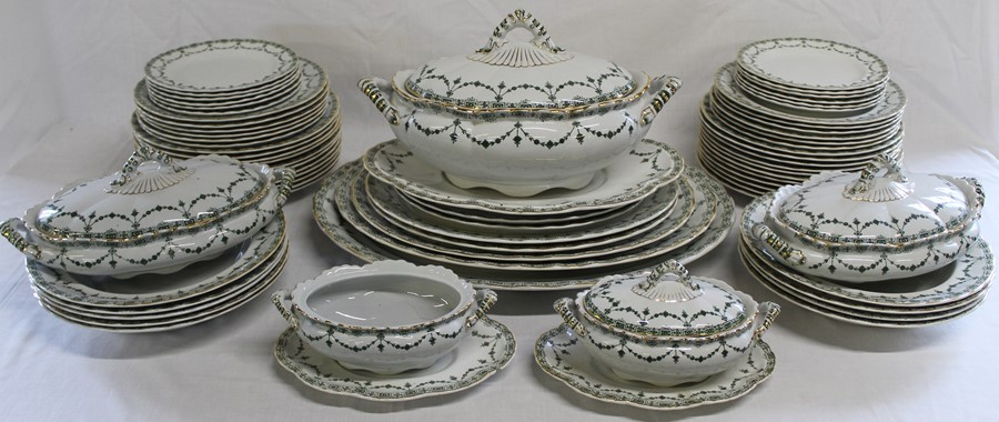 Keeling & Co green and gilt part dinner service retailed by Maple & Co, approximately 70 pieces