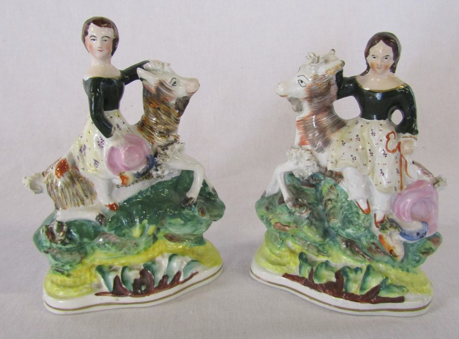 Pair of Staffordshire flatback figures of children / young girls riding goats possibly with some - Image 3 of 3