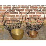 Pair of large wrought iron hanging baskets & 2 brass jam pans