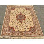 Kashmir full pile rug on gold ground with floral medallion design 170cm x 120cm