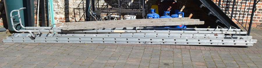 2 aluminium ladders, roof ladders and a set of wooden ladders