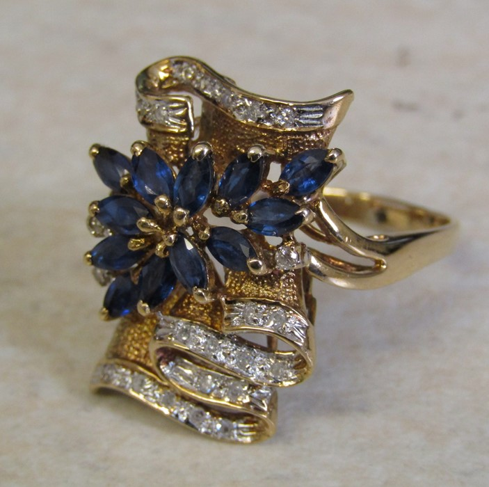 Tested as 14ct gold (marked 14k) sapphire and diamond ring, with 13 marquise cut sapphires 4 x 2.