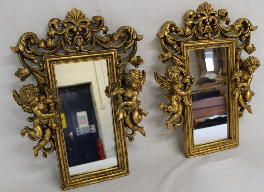 Pair of ornate gilt framed mirrors with cherub detail size approximately 44cm x 31cm at the widest - Image 2 of 2