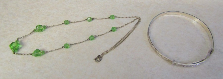 Sterling silver adjustable bangle 8.2 g & a silver and green bead necklace 3.4 g