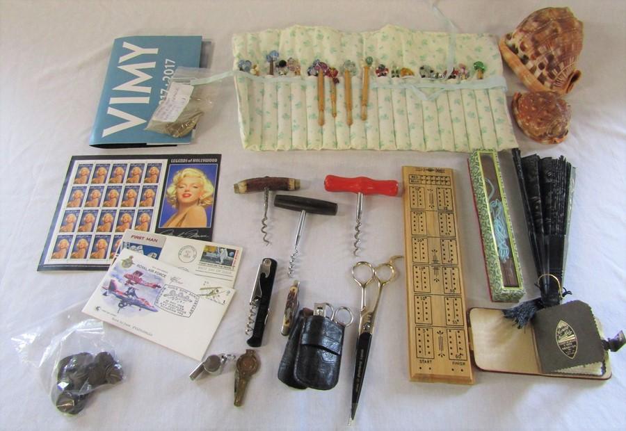 Various items in sea shells, lace bobbins, corkscrews, fans, stamps etc