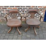 2 early 20th century captain's swivel chairs
