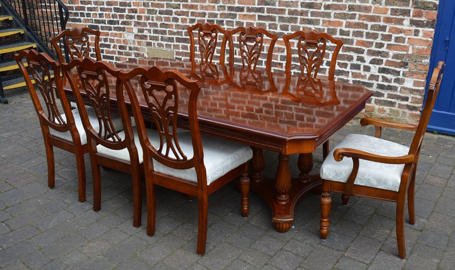 Mixed wood veneer twin pedestal dining table with single removable leaf and 8 chairs extending to