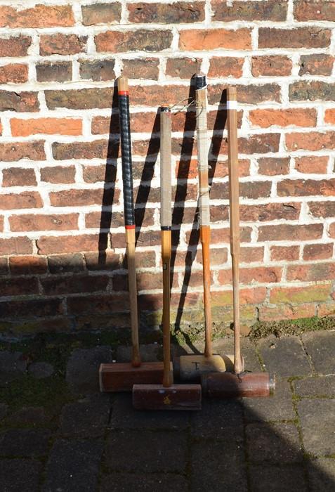 4 croquet mallets