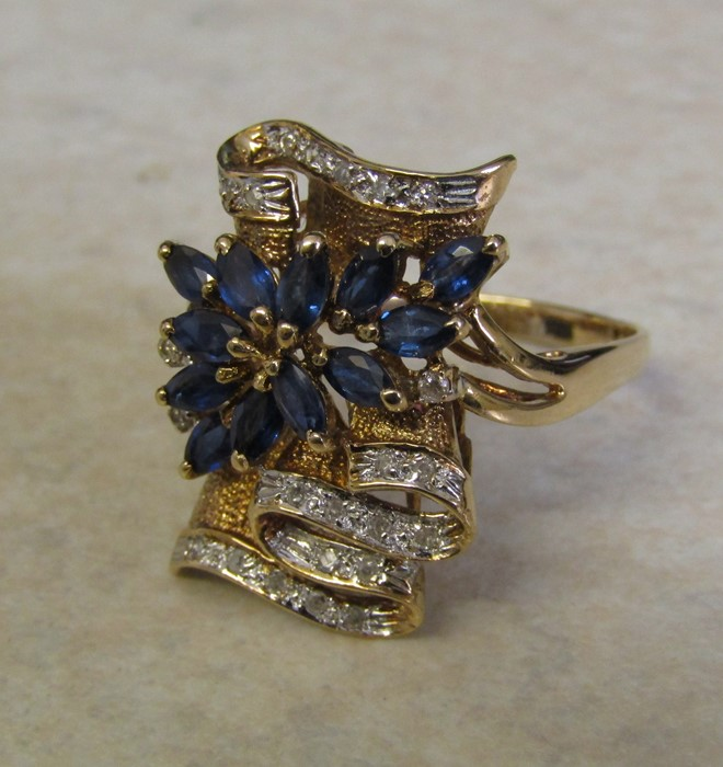 Tested as 14ct gold (marked 14k) sapphire and diamond ring, with 13 marquise cut sapphires 4 x 2. - Image 6 of 12