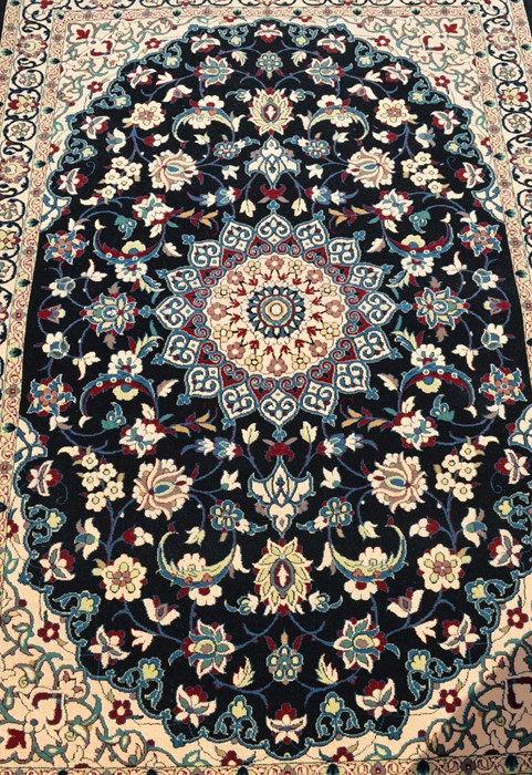 Fine woven full pile rug with black field & floral medallion 150cm x 100cm