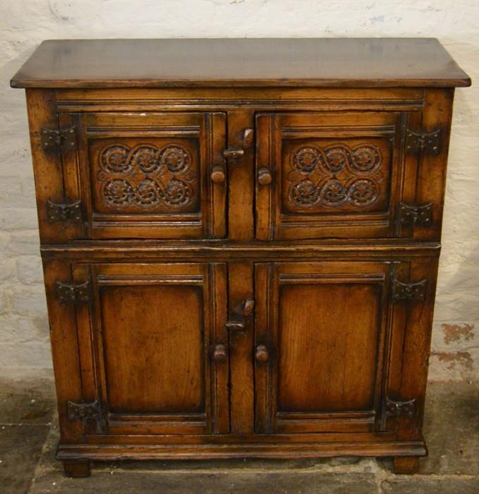 Titchmarsh & Goodwin 4 door Credence cupboard with guilloche carving to top door Ht 91cm W 84cm D