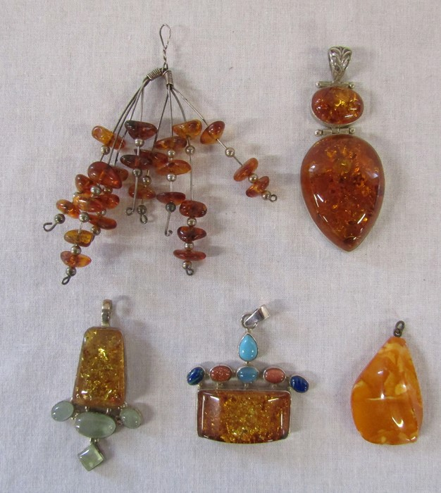5 silver and amber pendants (large strand pendant L 10 cm, 2 piece amber pendant L 8 cm, single