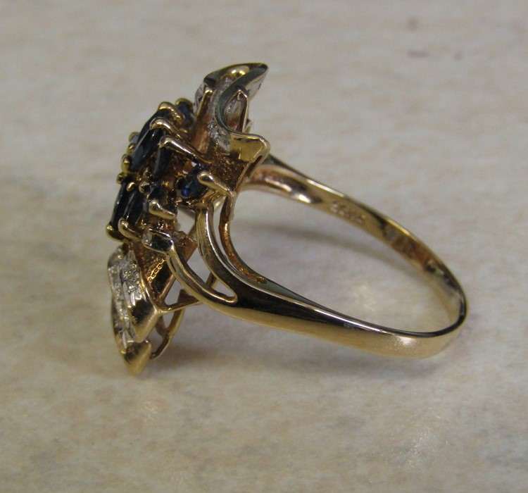 Tested as 14ct gold (marked 14k) sapphire and diamond ring, with 13 marquise cut sapphires 4 x 2. - Image 10 of 12